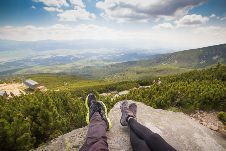 Couple Relaxing After Mountain Hiking