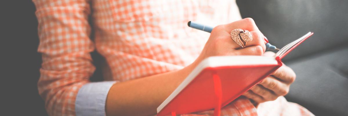 Girl Writing in her Moleskine Diary